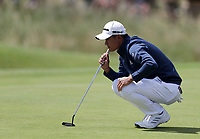 16th July 2021; Royal St Georges Golf Club, Sandwich, Kent, England; The Open Championship Tour Golf, Day Two; Collin Morikawa (USA) studies his birdie putt on the 12th green