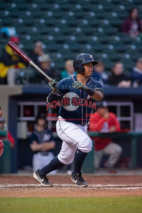 Northwest Arkansas Naturals catcher Meibrys Viloria (22) connects on a pitch on May 18, 2019, at Arvest Ballpark in Springdale, Arkansas. (Jason Ivester/Four Seam Images)