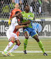 November, 2013: CenturyLink Field, Seattle, Washington:  Seattle Sounders FC defender Jhon Kennedy Hurtado (34) grabs the face of Portland Timbers forward/midfielder Ryan Johnson (9) as the Portland Timbers defeat  the Seattle Sounders FC 2-1 in the Major League Soccer Playoffs semifinals Round.