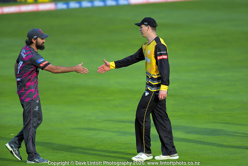 Northern Knights captain Dean Brownlie and Wellington's Michael Bracewell shake hands after the Dream11 Super Smash cricket match between the Wellington Firebirds and Northern Knights at Basin Reserve in Wellington, New Zealand on Friday, 3 January 2020. Photo: Dave Lintott / lintottphoto.co.nz