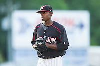 Kannapolis Intimidators starting pitcher Andre Wheeler (31) looks to his catcher for the sign against the Delmarva Shorebirds at CMC-NorthEast Stadium on July 1, 2014 in Kannapolis, North Carolina.  The Intimidators defeated the Shorebirds 5-2. (Brian Westerholt/Four Seam Images)