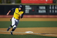 Gianni Arici (8) of the Quinnipiac Bobcats rounds third base against the Wake Forest Demon Deacons at David F. Couch Ballpark on February 24, 2019 in  Winston-Salem, North Carolina.  The Demon Deacons defeated the Bobcats 15-5.  (Brian Westerholt/Four Seam Images)