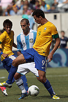 Brazil forward Leandro Damiao (9) heel pass as Argentina defender Pablo Zabaleta (4) defends. In an international friendly (Clash of Titans), Argentina defeated Brazil, 4-3, at MetLife Stadium on June 9, 2012.