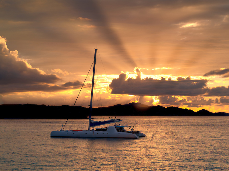 Sailboat off St. John, Virgin Islands and sunset.