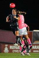Brittany Bock (5) of the Washington Freedom and Laura Kalmari (21) of Sky Blue FC go up for a header. Sky Blue FC and the Washington Freedom played to a 1-1 tie during a Women's Professional Soccer (WPS) match at Yurcak Field in Piscataway, NJ, on August 11, 2010.