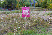 Closed trail sign (until summer 2017) at the start of the Mittersill-Cannon Hiking Trail on Mittersill Mountain in Franconia, New Hampshire during the autumn months.