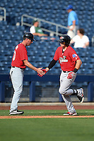 Frisco Rough Riders third baseman Ryan Rua (9) is congratulated by manager Jason Wood (40) after hitting a home run during the first game of a doubleheader against the Tulsa Drillers on May 29, 2014 at ONEOK Field in Tulsa, Oklahoma.  Frisco defeated Tulsa 13-4.  (Mike Janes/Four Seam Images)