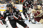 Robbie Vrolyk (NU - 91), Steven Whitney (BC - 21) - The Boston College Eagles defeated the Northeastern University Huskies 6-3 for their fourth consecutive Beanpot championship on Monday, February 11, 2013, at TD Garden in Boston, Massachusetts.