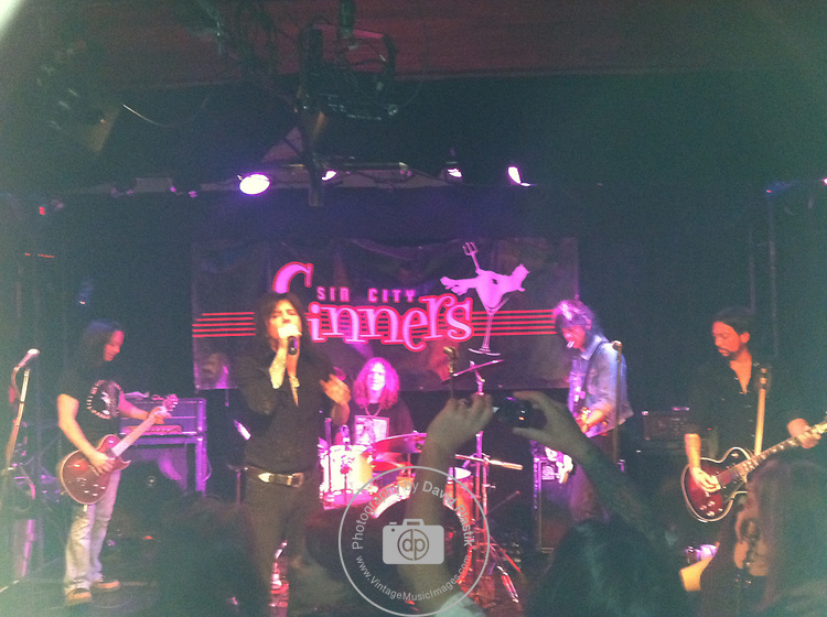 Brent Muscat, Rob Cournoyer, Doc Ellis of The Sin City Sinners with Phil Lewis & Scotty Griffin of LA Guns performing live in 2011.