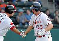 July 29, 2009: Catcher Ryan Lavarnway (33) of the Greenville Drive is congratulated by Jered Stanley after hitting a home run during a game at Fluor Field at the West End in Greenville, S.C. Photo by: Tom Priddy/Four Seam Images