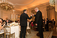 President Trump and the First Lady at a state dinner with the President of France and Mrs. Macron (Official White House Photo by Shealah Craighead)