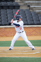 Greg Wasikowski (11) of the Bucknell Bison at bat against the Georgetown Hoyas at Wake Forest Baseball Park on February 14, 2015 in Winston-Salem, North Carolina.  The Hoyas defeated the Bison 8-5.  (Brian Westerholt/Four Seam Images)
