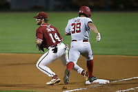 Arkansas infielder Cullen Smith (14) forces out Nebraska outfielder Mojo Hagge (39), Saturday, June 5, 2021 during the seventh inning in the second game of the NCAA Fayetteville Regional at Baum-Walker Stadium in Fayetteville. Check out nwaonline.com/210606Daily/ for today's photo gallery. <br /> (NWA Democrat-Gazette/Charlie Kaijo)