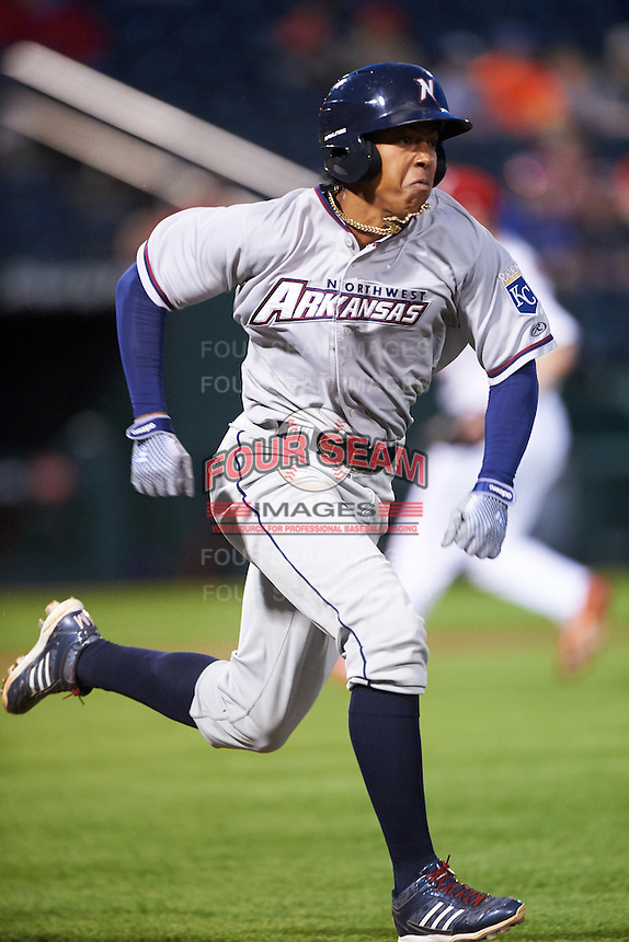 Northwest Arkansas Naturals second baseman Raul Mondesi (27) runs to first during a game against the Springfield Cardinals on April 26, 2016 at Hammons Field in Springfield, Missouri.  Northwest Arkansas defeated Springfield 5-2.  (Mike Janes/Four Seam Images)