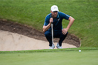 22.05.2015. Wentworth, England. BMW PGA Golf Championship. Round 2. Ross Fisher [ENG]  lines up a putt on the 18th Green.