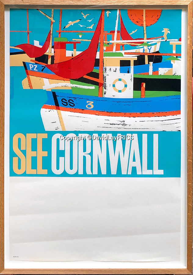 BNPS.co.uk (01202 558833)<br /> Pic: DavidLayFRICS/BNPS<br /> <br /> A colourful poster promoting Cornwall<br /> <br />  A wonderful collection of vintage British travel posters celebrating the golden age of the seaside getaway have emerged for sale for £15,000.<br /> <br /> The posters were produced by Great Western Railway and British Railways between the 1930s to the 1960s to encourage Brits to holiday on the Cornish coast.<br /> <br /> One striking Art Deco poster issued by Great Western Railway shows a lady in an orange swimsuit at Newquay with surfers in the background. <br /> <br /> It describes the popular holiday destination as 'Cornwall's first Atlantic resort'.<br /> <br /> The collection of about 30 posters has been put together by a private collector over the past two decades who is now selling them with auction house David Lay FRICS, of Penzance, Cornwall.