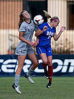 Marina Paul (5) of Georgetown goes up for a header with Gini Yost (5) of DePaul during the game at Shaw Field on the campus of Georgetown University in Washington, DC.  Georgetown tied DePaul, 1-1, in double overtime.