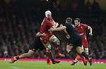 Luke Charteris runs into trouble as the All Blacks defence closes in.<br /> Dove men Series 2014<br /> Wales v New Zealand<br /> 22.11.14<br /> ©Steve Pope -SPORTINGWALES