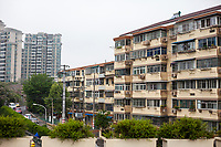 Nanjing, Jiangsu, China.  Apartment Building with Individual Air Conditioners for Each Flat.  Note Solar Water Heater on Roof.