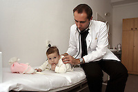 The polish doctor checking a five months old chechen baby in the medical clinic of the URiC Bielany Refugee Centre, in Poland..-For security reason, the face of the adult asylum seeker have been evicted of the photography..-For security reason, the names of the adult asylum seeker have been change. .-Article 9 of the Act of 13 June 2003 on grating protection on the Polish territory (Journal of Laws, No 128, it. 1176) personal data of refugees are an object of particular protection..-Cases where publication of a picture or name of asylum seeker had dramatic consequences for this persons and is family back in Chechnya. .Please have safety of those people in mind. Thank you.