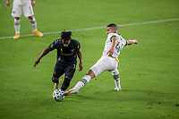 LOS ANGELES, CA - SEPTEMBER 13: Latif Blessing #7 of LAFC and Portland Timber's Marvin Loria #44 reach for the ball during a game between Portland Timbers and Los Angeles FC at Banc of California stadium on September 13, 2020 in Los Angeles, California.