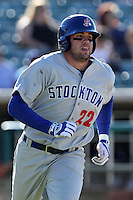 Josh Whitaker #22 of the Stockton Ports runs to first base against the Lancaster JetHawks at Clear Channel Stadium on July 8, 2012 in Lancaster, California. Lancaster defeated Stockton 10-8. (Larry Goren/Four Seam Images)