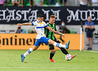 AUSTIN, TX - JUNE 19: Zan Kolmanic #21 of Austin FC and Cristian Espinoza #10 of the SJ Earthquakes battle for control of the ball during a game between San Jose Earthquakes and Austin FC at Q2 Stadium on June 19, 2021 in Austin, Texas.