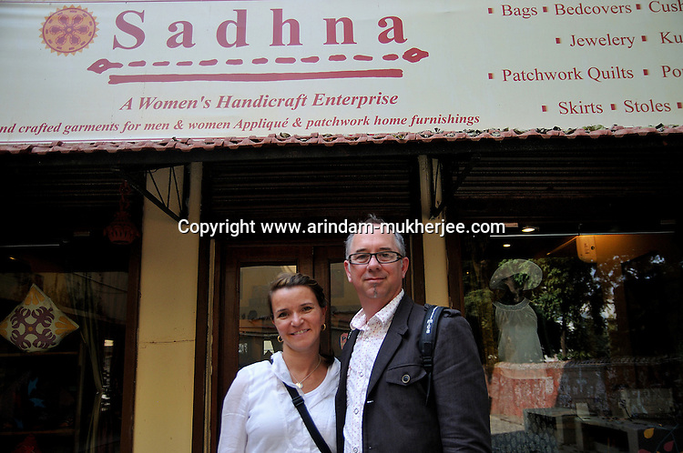 """Mr. Mark Kayen, Director of visual maketing(North America) of Olsen and Ms. Leanne Nicolle, Drector (Corporate Development) of Plan Cananda pose for a photograph in front of the showroom of """"Sadhana"""" in Udaipur, Rajasthan, India. 24.1.2011. Arindam Mukherjee"""