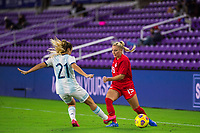ORLANDO, FL - FEBRUARY 21: Adriana Leon #19 of the CANWNT passes the ball during a game between Argentina and Canada at Exploria Stadium on February 21, 2021 in Orlando, Florida.