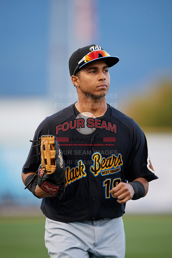 West Virginia Black Bears left fielder Edison Lantigua (18) jogs back to the dugout during a game against the State College Spikes on August 30, 2018 at Medlar Field at Lubrano Park in State College, Pennsylvania.  West Virginia defeated State College 5-3.  (Mike Janes/Four Seam Images)