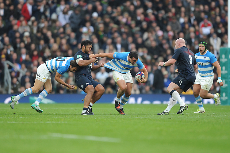 Agustín Creevy of Argentina is held by Billy Vunipola of England during the Old Mutual Wealth Series match between England and Argentina at Twickenham Stadium on Saturday 26th November 2016 (Photo by Rob Munro)