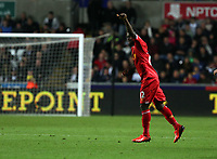 Pictured:Victor Moses of Liverpool celebrating his goal, making the score 1-2. Monday 16 September 2013<br /> Re: Barclay's Premier League, Swansea City FC v Liverpool at the Liberty Stadium, south Wales.