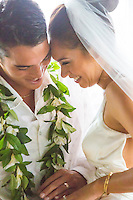 Happy couple laugh together after getting married in Hau'ula, O'ahu.