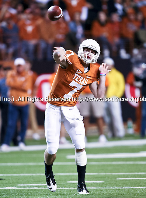 Texas Longhorns quarterback Garrett Gilbert (7) throws a pass in the game between the Oklahoma State Cowboys and the University of Texas in Austin Texas Longhorns at the Daryl K. Royal- Texas Memorial Stadium in Austin, Texas. The Oklahoma State Cowboys defeated the Texas Longhorns 33 to 16.