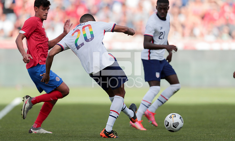 SANDY, UT - JUNE 10: Reggie Cannon #20 of the United States takes a shot during a game between Costa Rica and USMNT at Rio Tinto Stadium on June 10, 2021 in Sandy, Utah.