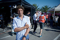 'Aloha' from ex-rider turned surfer turned cycling commentator Juan-Antonio Flecha (ESP) is reporting the 2015 Giro for Eurosport<br /> <br /> finish zone of stage 1: San Lorenzo Al Mare - San remo (TTT/17.6km)