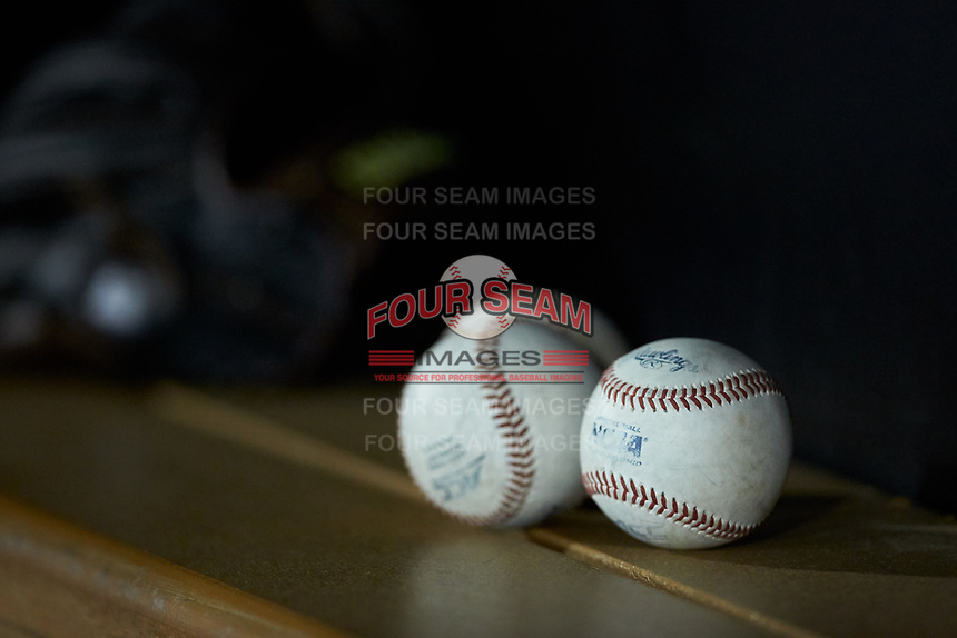 Several ACC baseballs sit on the bench in the Wake Forest Demon Deacons dugout during the game against the Davidson Wildcats at David F. Couch Ballpark on May 7, 2019 in  Winston-Salem, North Carolina. The Demon Deacons defeated the Wildcats 11-8. (Brian Westerholt/Four Seam Images)
