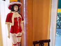 Switzerland. Canton Ticino. Lugano. Inside a cafe, a woman dummy wearing sexy red underwear . 8.12.12  © 2012 Didier Ruef