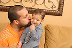 Young father with 16 month old toddler son, interaction