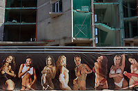 Sunny Beach, Nesebar, Bulgaria..Advertising for a strip club in front of a construction site at Sunny Beach, the largest holiday resort in the Balkans, and a popular destination for cheap foreign package tours. Rapid overdevelopment of the Back Sea coast has led to widespread environmental destruction, and many properties lie uncompleted or empty.