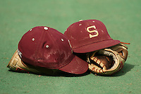 25 April 2007: Baseball hat and glove during Stanford's 7-2 win over Fresno State at Sunken Diamond in Stanford, CA.