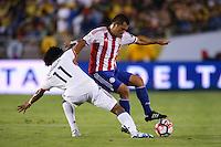 Pasadena, CA - Tuesday June 07, 2016: Paraguay defender Miguel Samudio (6) and Colombia midfielder Juan Cuadrado (11) during a Copa America Centenario Group A match between Colombia (COL) and Paraguay (PAR) at Rose Bowl Stadium.