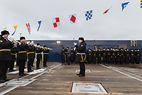 A band plays at the inaguration ceremony for the 'Fedor Ushakov', a multifunctional ice-breaking vessel moored in Murmansk prior to its navigation along the Northern Sea Route. The ship is designed to provide the year-round delivery of supplies to offshore oil platforms operating in waters off Sakhalin, and standby assistance for emergency cases. The vessel is able to hold 150 passengers, sufficient in the case of a platform evacuation.