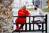 27th March 2021; Sakhir, Bahrain; F1 Grand Prix of Bahrain, Qualifying sessions;  SCHUMACHER Mick (ger), Haas F1 Team VF-21 Ferrari in discussion with a Scuderia Ferrari Driver Academy staff during Formula 1 Gulf Air Bahrain Grand Prix 2021 from March 26 to 28, 2021 on the Bahrain International Circuit, in Sakhir, Bahrain