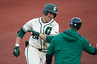 David McCabe (24) of the Charlotte 49ers rounds the bases after hitting a home run during the game against the Tennessee Volunteers at Hayes Stadium on March 9, 2021 in Charlotte, North Carolina. The 49ers defeated the Volunteers 9-0. (Brian Westerholt/Four Seam Images)