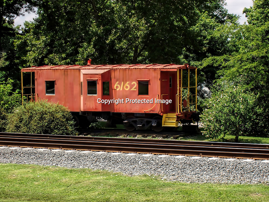 Old red Caboose off of the southern railroad in rural Tennessee.