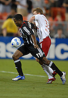 DC United forward Luciano Emilio (11) controls the ball against New York Red Bulls defender Chris Leitch (33). DC United defeated the New York Red Bulls 3-1, at RFK Stadium in Washington DC, Thursday August  22, 2007.