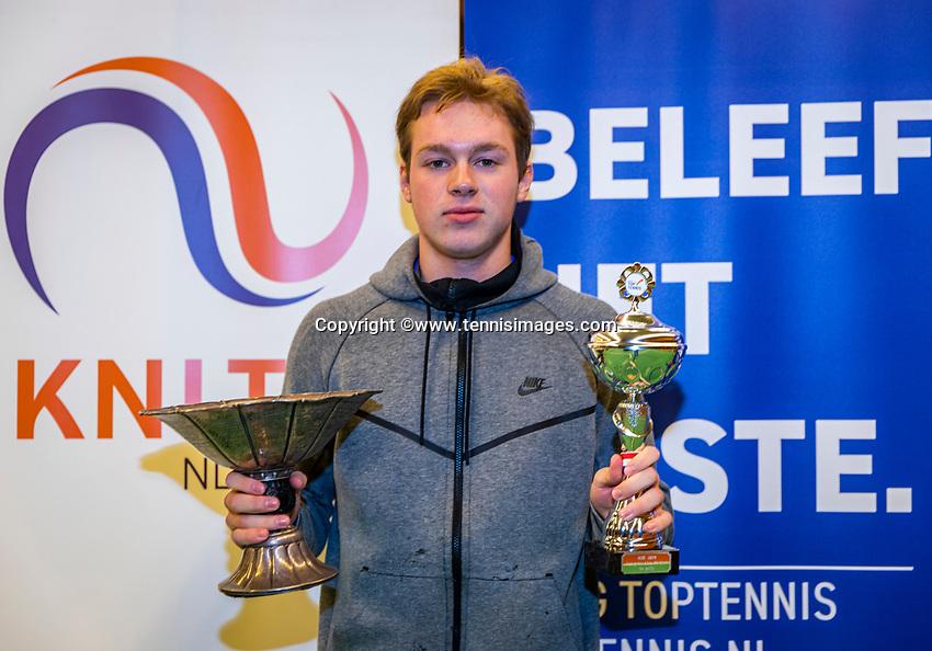 Wateringen, The Netherlands, December 1,  2019, De Rhijenhof , NOJK 12 and16 years, Winner boys 16 years:  Miko Wassermann (NED) with the trophy<br /> Photo: www.tennisimages.com/Henk Koster