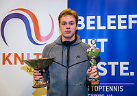Wateringen, The Netherlands, December 1,  2019, De Rhijenhof , NOJK 12 and16 years, Winner boys 16 years:  Miko Wassermann (NED) with the trophy<br /> Photo: www.tennisimages.com/Henk Koster