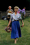 'ENGLISH VILLAGE FETE', MRS RICHARD BRINGS TO THE FETE HER ENTRY IN THE FLOWER ARRANGING COMPETITION.